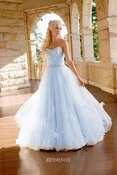 Strapless sky blue colored informal ball gown wedding dress, beaded bodice, natural waistline, full A-line skirt. Floor length skirt with sweep train.