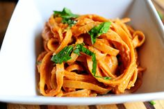 Pasta with Tomato Cream Sauce - Canned tomato sauce, heavy cream, onion, garlic, Parmesan, and fresh basil.