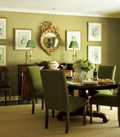 A celery-green cheetah fabric covers the walls in this dining room. Green covers the dining chairs as well and even extends to the botanical prints on the wall. - Traditional Home ® / Photo: Deborah Whitlaw Llewellyn / Design: Bill Murphy