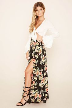 A woven maxi skirt featuring a floral print, M-slit front, and elasticized panel in back.