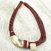 Handmade Red Leather Necklace with Horn and Bone Pendants - Sougri Paprika | NOVICA