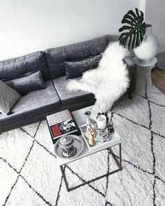 Interior Inspiration. Grey velvet Sofa and marble Coffee Table with Decorations. Check out my weekly reviews on: designdschungel.com