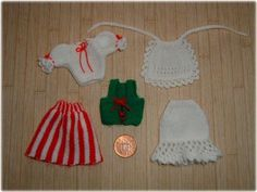 Butter cup miniatures has an advent calendar that shares instructions for these knitted clothes. Ready-steady-go your knitting needles! :)