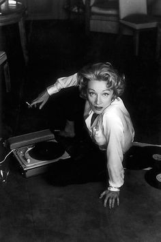 Marlene Dietrich and her Tepaz Gramaphone, Cannes, 1956 by Willy Rizzo