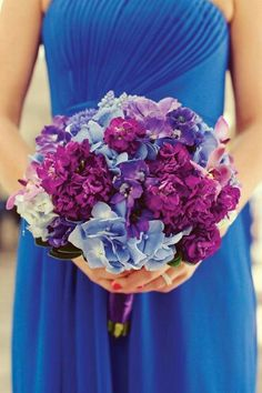 Bridesmaid's Lovely Bouquet Comprised Of: Blue & Purple Jumbo Hydrangea, Fuchsia & Purple Stock, Pink Orchids, & Blue Grape Hyacinth