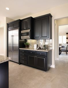 moon white granite, dark kitchen cabinets. | kitchen ideas