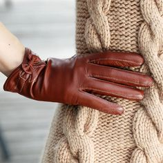 We don't get a lot of glove weather here in Houston, but when we do - I want to wear these leather gloves with the little bows!  So sweet!