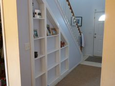 Hidden room under the stairs - you only get a tiny glimpse but can get the general idea