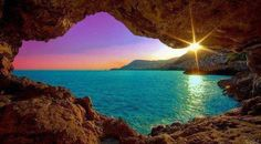 Amazing sunrise through an Ocean Cave | From @GuessQuest collection