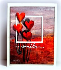 Rapport från ett skrivbord. Soft Caress and Heartfelt dies were used along with encaustic wax to make this colourful card. The frame adds interest to the design.