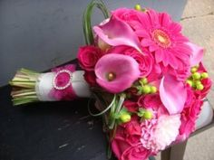 Wedding Bouquets Hot Pink Roses but also add other shades of pink and variety of types of flowers