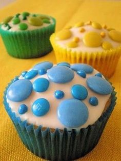 Polka dot cupcakes with mini and regular M and jumbo chocolate covered pieces. So cute!