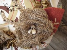 Easy to follow instructions at CrystelleBoutique  Video on how to make this burlap rose