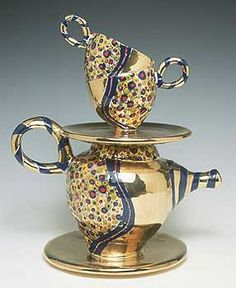 """Inspired by the daily chore of stacking dishes in the sink, Joan Takayama-Ogawa created the """"Gilded Tea Tower,"""" above. The china-painted surface includes generous touches of gold luster over porcelain."""