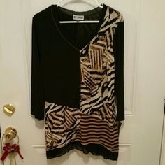 Top Ladies top in animal prints, stripes, n solid black. Brand new, never worn still with original tags. JM Collection  Tops Tunics