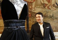 Designer Zuhair Murad stands amongst some of his creations which he displayed as part of the Fall-Winter, ready-to-wear 2013 fashion collection, during Paris Fashion week, Saturday, March 3, 2012.