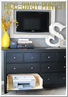 hiding the printer.... LOVE the frame around the TV!!