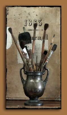Love this idea......silver urn with brushes.
