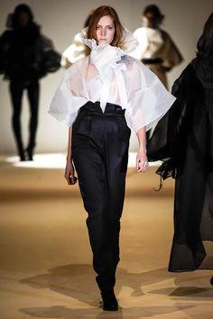 Dramatic menswear look all by Nabil Nayal. Cotton Organdie Kimono blouse with knife pleat ruffle collar. Silk cashmere dinner trouser and cummerbund.