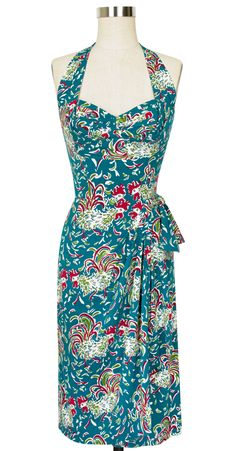 Make a statement this summer with the ruffled feathers collection! Featuring new and classic styles, this bold print perfectly captures the vivacious spirit of the 1940s. Feminine and pretty, the Lena Halter Sarong Dress is perfect for summertime in our new light and airy stretch rayon fabric. This halter style has a sweetheart neckline with versatile fit through the bust to flatter a variety of shapes and sizes.