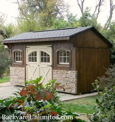 8'x15' Quaker Shed with Carriage House Door, Wood Arched Windows, Stone Veneer, and Ridge Vent http://www.backyardunlimited.com/sheds.php