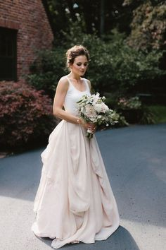 Kensington is one of my all time favorite gowns.  The simplicity of the  silk jersey ballet tank paired with softly draped open weave linen layers  has a romance and casual elegance to it that just strikes all the right  chords.   Kelsey's intimate backyard wedding in Michigan was  so clearly  planned with personal connection to each of the thirty attendees in mind  and perfectly matched Kensginton's relaxed vibes. Such a sweet celebration!  Carol Hannah Kensington gown Real Wedding Carol…