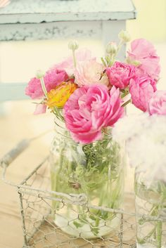 pretty flowers in a mason jar displayed in a wire basket