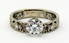 Hand-engraved diamond engagement ring in palladium white gold by Dmitriy Pavlov. Available at Studio Jewelers Hand Piercing, Hand Engraving, Handcrafted Jewelry, Bridal Jewelry, Jewelry Crafts, Diamond Engagement Rings, White Gold, Jewels, Studio