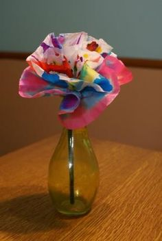 My boys made coffee filter flowers for me a couple of years ago ... they lasted a surprisingly long time! It's a great craft for younger kids ~ no need to color inside the lines!