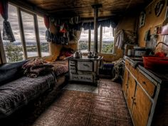 wood stove in central position ~ seen on a northern cabin