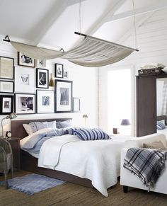 You can create your own dreamy bed canopy by using curtain rods, hung from the ceiling, to drape a beautiful fabric.