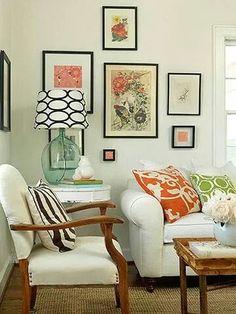 Orange art in frames.