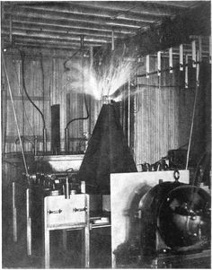 One of Tesla's coils at his New York lab in 1895 with a conical secondary…