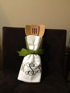 Monogrammed towel with wooden spoons in an oven mitt. Great little gift