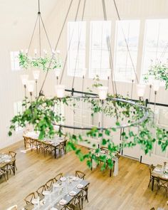 On trend and intimate. 🌿 Delicate vines make for the prettiest wedding day decor. Who agrees?! Positioned up high, these eye catching chandeliers draw guests' attention above, making the venue space feel even bigger. We 💚 this minimalist design by @rachaelellenevents! | Photography: @bransonmaxwell.photo #stylemepretty #weddingday #weddinginspiration #weddinggreenery #weddingvenue #weddingdecor Head Table Wedding, Wedding Reception Centerpieces, Wedding Reception Decorations, Wedding Venues, Romantic Weddings, Real Weddings, Barn Weddings, Taupe Wedding, Wedding Photography And Videography