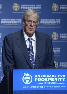 Americans for Prosperity, the political nonprofit formed with the backing of conservative billionaires David and Charles Koch, gave a $100,000 grant to another dark money group linked to the Kochs in 2012, according to tax forms filed Friday with the IRS.