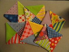 As promised, here are the directions for making the Criss-Cross Coasters another way -- with triangles. Again, I used a Moda charm pack. Thi...