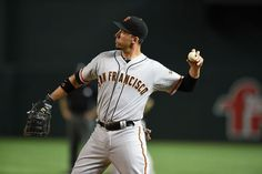 PHOENIX, AZ - SEPTEMBER 15: Travis Ishikawa #45 of the San Francisco Giants throws the ball around the infield during the eighth inning against the Arizona Diamondbacks at Chase Field on September 15, 2014 in Phoenix, Arizona. Arizona won 6-2. (Photo by Norm Hall/Getty Images)