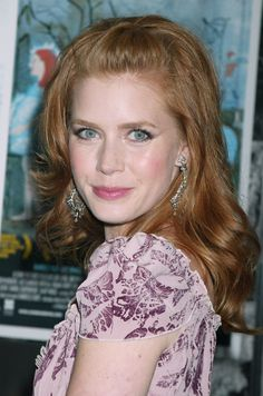 Adams arrives at the New York City premiere of her film Junebug, where she received her first Oscar nomination. Adams kept her red locks pinned back, with a pink lip and subtle smoky eye.