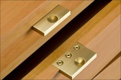 Douglas fir cabinet: close-up, detail of brass drawer handles