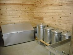 Organized feed room. (metal feed bins will keep out rodents - chew proof!)