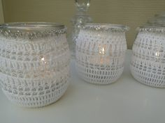 Tea light holders 5,  white crochet around glass container with silver pearls. €15.00, via Etsy.
