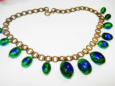 FAB Peacock Eye Foil Glass Bib Bookchain Necklace from decadentdiva on Ruby Lane