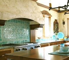 Pretty turquoise tile makes a statement in this Mediterranean style kitchen.