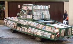 """Weapon of Mass Instruction // Way cool book tank created by Argentinean artist, Raul Lemesoff, with a 1979 Ford Falcon from the former military junta. Lemesoff tours from the streets of Buenos Aires to the countryside, offering his 900, donated, frequently-replenished books free as a """"contribution to peace through literature.""""  #library #motion"""