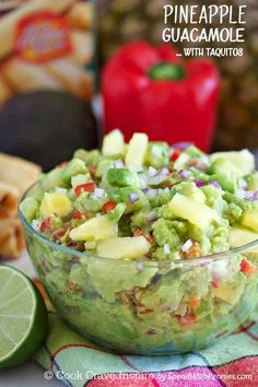 Pineapple Guacamole! Buttery avocado & fresh pineapple make the perfect dip for taquitos & chips! This dip can be made with or without cilantro!