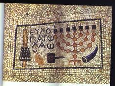 """Menorah mosaic, Hulda, Byzantine period, 5th-6th century CE.Mosaic floor with seven-branched menorah from the Temple in Jerusalem, plus other Jewish ritual objects, from right to left, a shofar (ram's horn used on the Rosh haShanah holiday); an incense shovel as used in the Temple; an etrog (citron), a citrus fruit used on the Sukkot holiday; and a lulav, a palm frond, also used on the Sukkot holiday. The Greek inscription says """"Praise for the People."""" Temple In Jerusalem, Ram Horns, Iron Age, Menorah, Byzantine, Mosaic, Art Gallery, Bohemian Rug, Objects"""