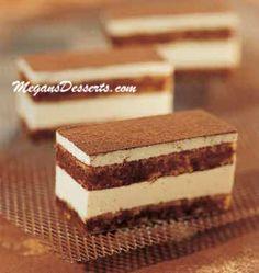 Tiramisu Big Layers of espresso drenched sponge cake divided by mascarpone cream, with cocoa powder. https://www.megansdesserts.com/bindi/tiramisu-big-ladyfinger-whole-details.html