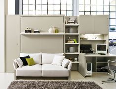 Italian murphy beds are unlike any other. The popular Nuovoliola transforms any space into a bedroom. The front sofa and bookshelf, through a smooth and easy mechanism, transforms into a double bed always ready to use provided with an innovative slatted bed base with aluminum frame. The sofa is provided with a storage space underneath the seat. Manufactured by Clei.