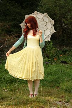 love this, except that yellow would not go well with my skin.... so lets try white dress with the blue sweater i guess.... brown hair down and curled... and barefeet? :D